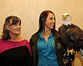 Posing for picture with Bald Eagle. (10595590294).jpg