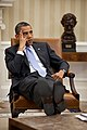 President Barack Obama listens during a meeting with advisors in the Oval Office.jpg