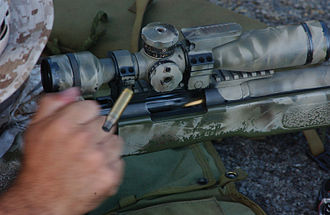 Sniper rifle - A Marine manually extracts an empty cartridge and chambers a new 7.62×51mm round in his bolt-action M40A3 sniper rifle. The bolt handle is held in the shooter's hand and is not visible in this photo.