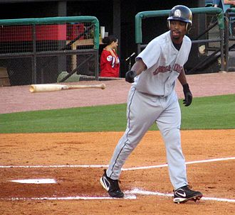 Base on balls - Rashad Eldridge of the Oklahoma Redhawks walks to first base after drawing a base on balls.