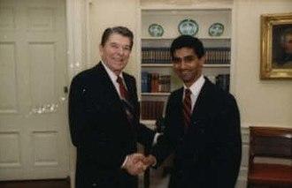 Dinesh D'Souza - D'Souza greeting President Ronald Reagan in 1988