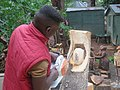 Right Mukore carving a tree into a woman lifting a heart at Montebello Bibiloucapetown Essay Photo 6 IMG 0855.jpg