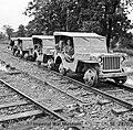 Road-rail Jeeps between Myitkyina and Mogaung, Burma, December 1944 (IWM SE 002870).jpg
