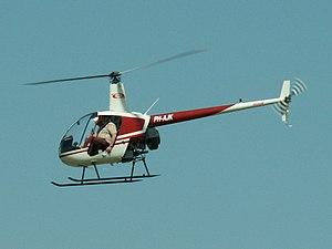 Robinson R22 Beta PH-AJK at Teuge airport.jpg