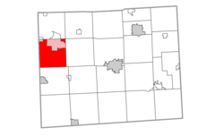 Location within Lenawee County (red) and portions of the administered village of Addison and communities of Manitou Beach–Devils Lake (pink)