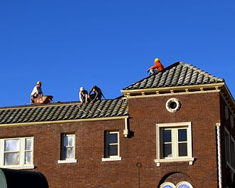 Roofer - Roofers laying a tiled roof in Denver, Colorado