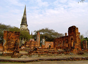 Burmese–Siamese War (1547–49) - Ruins of the Royal Palace of Ayutthaya, in the Ayutthaya Historical Park, Phra Nakhon Si Ayutthaya Province. The stupas of the royal chapel (Wat Phra Si Sanphet) is in the background.