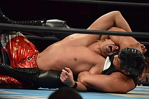 Seiya Sanada - Sanada applying the Skull End on Yoshi-Hashi