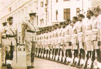 Sri Lanka Army - Brigadier James Sinclair, Earl of Caithness inspecting a guard of honour wearing khaki drill.