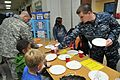 Sailors hand out supplies to South Korean students 120330-N-UN744-009.jpg