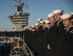 Sailors man the rails aboard the aircraft carrier USS Dwight D. Eisenhower (CVN 69) as it returns to homeport (31608632820).jpg