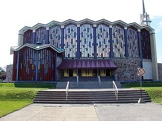 Mercier–Hochelaga-Maisonneuve - Sanctuaire Marie-Reine-des-Coeurs, located on Sherbrooke East street, is in the borough.