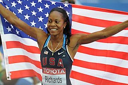 Sanya Richards with US flag Berlin 2009.JPG