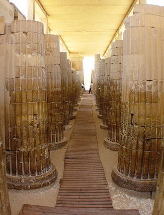 Pyramid of Djoser - Roofed colonnade corridor leading into the complex, with stone pillars carved to imitate bundled plant stems.