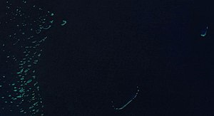 Frederick Reefs - Satellite View of Saumarez reefs (center) and the Swains reef (Left part of the Great Barrier Reef) and Frederick Reefs (right)
