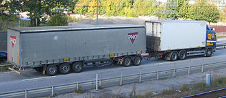 Trailer (vehicle) - A truck pulling a semi-trailer using a trailer dolly