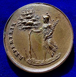Peace of Westphalia - The reverse of this medal: Christina of Sweden as Minerva standing l., holding an olive branch in her l. arm, and grasping the tree of knowledge with her r. hand.