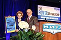 Senator Stabenow accepts the Champion of Dairy Award from Ken Nobis, President of the Michigan Milk Producers. (13428983664).jpg