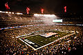 Service members unfurl flag at NY Jets first home game at new Meadowlands Stadium.jpg