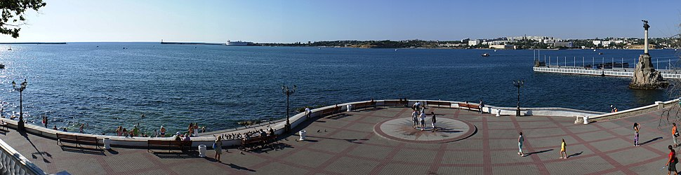 Panorama of the Sevastopol port entrance (left) with its monument to Russian ships which were sunk in the Crimean war to blockade the harbour (far right side).