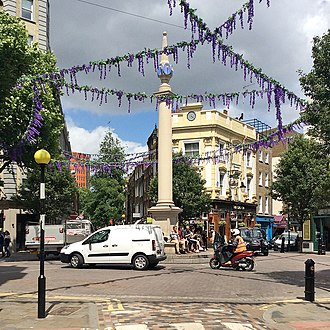 Seven Dials, London - The Seven Dials junction and sundial, as seen from Monmouth Street.