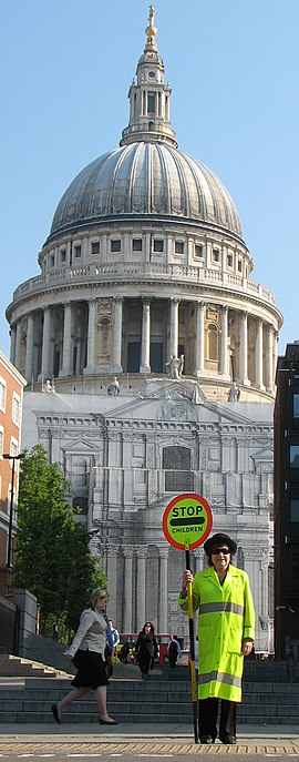 "A London ""lollipop lady"" with St. Paul's Cathedral in the background. SheilaGallagherLollipopLadyStPauls.jpg"