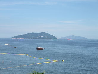 "Wanshan Archipelago - Shek Kwu Chau (left), an island of Hong Kong and Wai Lingding Dao (right), part of the ""Central group"" of Wanshan Archipelago."
