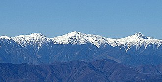 Mount Kita - Shiranesanzan (from left to right: Mount Nōtori, Mount Aino, Mount Kita), view from Mount Kenashi in Shizuoka Prefecture (November 2006)