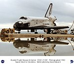 Shuttle Columbia Post-landing Tow - with Reflection in Water DVIDS687812.jpg