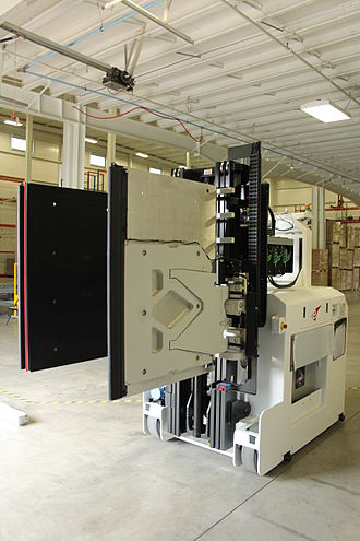 Automated guided vehicle - Side Clamp AGVs can pick unpalletized loads.