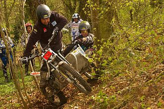 Motorcycle trials - A sidecar trials bike competing in an observed section