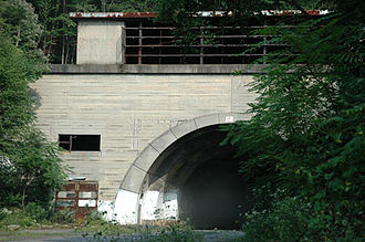 Sideling Hill -  The western portal of the now-abandoned Sideling Hill Tunnel, along the former mainline of the Pennsylvania Turnpike.