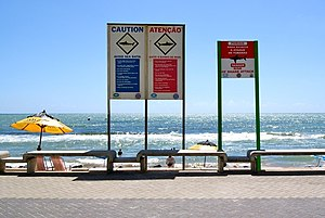 Signs warning of shark attacks at Boa Viagem Beach in Recife, Brazil