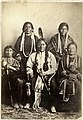 Sitting Bull and family 1881 at Ft Randall rear L-R Good Feather Woman (sister), Walks Looking (daughter) front L-R Her Holy Door (mother), Sitting Bull, Many Horses (daughter) with her son, Courting a Woman.jpg