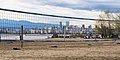 Skyline of Vancouver seen through volleyball nets at Spanish Banks.jpg