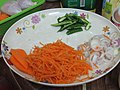 Slices of carrot, onion and green chili.jpg