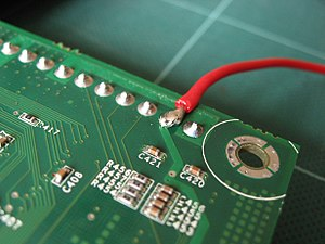 Solder - A soldered joint used to attach a wire to the pin of a component on the rear of a printed circuit board