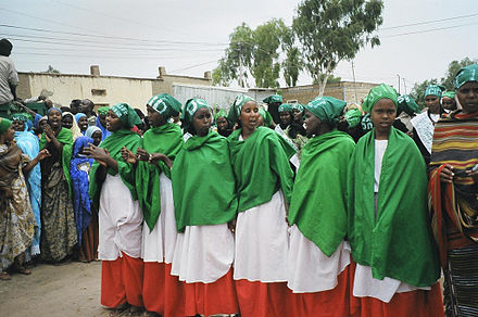 Women in Somaliland wearing the colors of the Somaliland flag, prior to parliamentary elections in 2005. Somaliland UCID elections rally.jpg