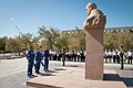 Soyuz MS-15 backup crew at the statue of Sergei Korolyov.jpg