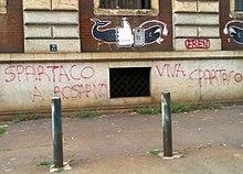 Spartaco a Rosarno: graffito a Torino che collega la figura di Spartaco con gli scontri di Rosarno del 2010