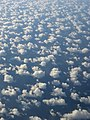 Spectacular Mid-Pacific Clouds somewhere near the Cook Islands on a flight from Auckland, New Zealand to Papeete, Tahiti - panoramio.jpg