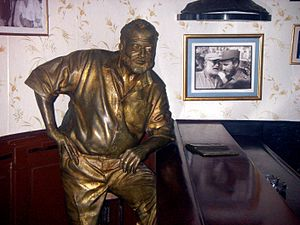 Floridita - 2003 statue of Ernest Hemingway by José Villa Soberón inside El Floridita bar, at the wall end of the bar (see photo at beginning of article). A photograph of Hemingway awarding Fidel Castro a prize in a fishing contest in May 1960 (almost a year and a half after the Cuban revolution) adorns the wall behind the statue.