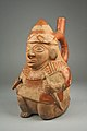 Stirrup Spout Bottle with Kneeling Warrior MET 64.228.32.jpeg