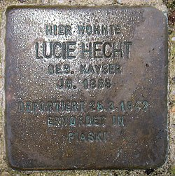 Photo of Lucie Tana Hecht brass plaque