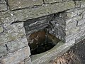 Stone trough in the wall opposite the Rose and Crown - geograph.org.uk - 947676.jpg