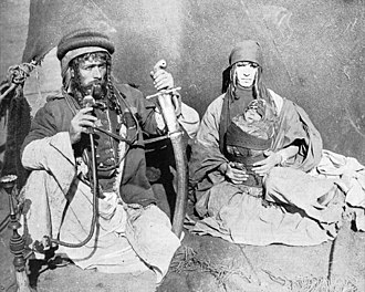 Syrian bedouin, 1893 Syrian Bedouin Kahlil Sarkees with family,1893 World's Columbian Exposition.jpg