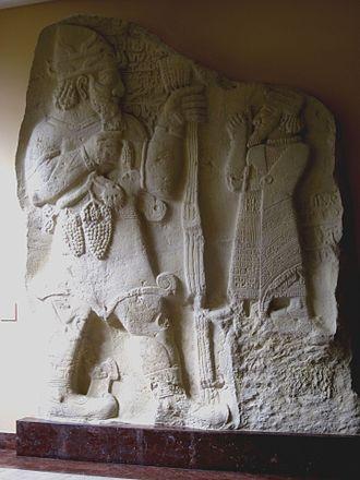 Teshub - Teshub (left) being worshipped by king Warpalawas of Tyana
