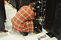 Technician with laptop working on server rack at NERSC.jpg