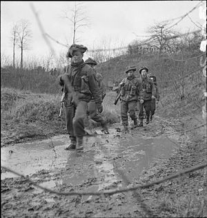 52nd (Lowland) Infantry Division - Men of 'C' Company of the 4th Battalion, King's Own Scottish Borderers, move up to attack a pillbox, the Netherlands, 11 December 1944.