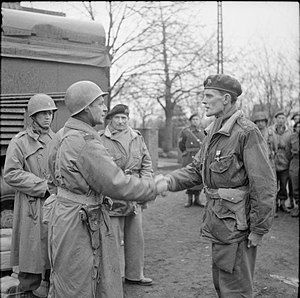 James Hill (British Army officer) - Major General Matthew Ridgway, commander of U.S. XVIII Airborne Corps, (left) decorates James Hill with the American Silver Star, 1945. Pictured also in the middle is Field Marshal Bernard Montgomery.